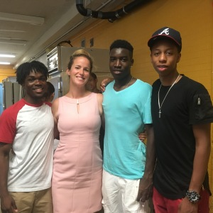 Chrystina Russell, founding principal of Global Tech with (from left) Quentin, who is going to Monroe College in New Rochelle; Travis, who is going to New York City Tech/CUNY; and Dariel who has been studying to be an auto mechanic and will attend Duchess Community College